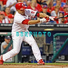 September 7, 2011 Philadelphia Phillie's, #27 3rd baseman, Placido Polanco, reaches for a pitch during the game against the Atlanta Braves at Citizens Bank Park in Philadelphia, PA. The Phillie's defeated the Braves 3-2.