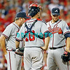 September 7, 2011 Atlanta Braves pitching coach, Roger McDowell #45 and catcher, Brian McCann, #16 have a mound meeting with pitcher Brandon Beachy during the game against the Atlanta Braves at Citizens Bank Park in Philadelphia, PA. The Phillie's defeated the Braves 3-2.