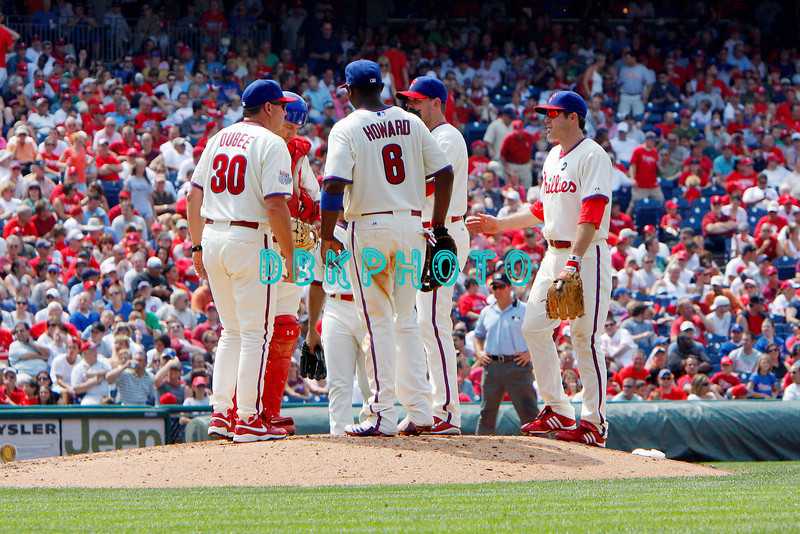 July 22, 2009: Phillies acting manager Rich Dubee (30) joins other Phillies players on the mound to replace starting pitcher Jamie Moyer during the game between the Chicago Cubs and the Philadelphia Phillies at Citzens Bank Park in Philadelphia, PA. The Cubs ended the Phillies 10 game winning streak by defeating them 10-5. Donald B. Kravitz/CSM