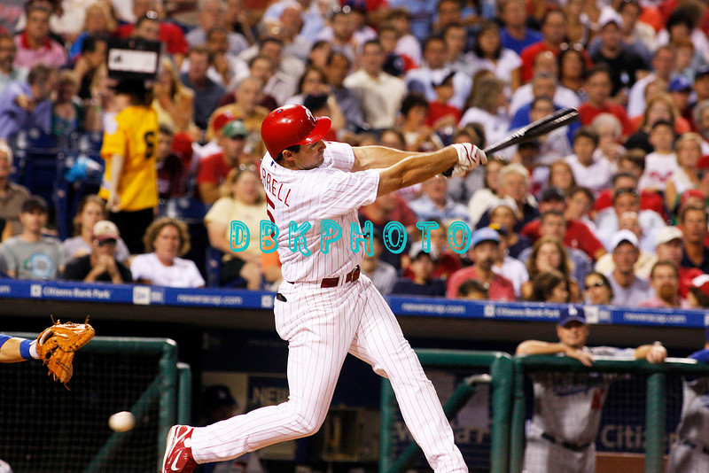 25 August 2008: Philadelphia Phillies' Leftfielder, Pat Burrell (5) swings and misses al a low pitch during the game against the Los Angeles Dodgers. The Phillies defeated the Dodgers 5-0 in Citizens Bank Stadium in Philadelphia, PA