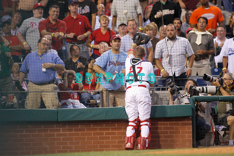 27 August 2008: Philadelphia Phillies' catcher Chris Coste (27) races to the stands on a foul pop-up in the game against the New York Mets. The Mets. The Mets went on to win defeating the Phillies' 6-3 in Citizens Bank Stadium in Philadelphia, PA