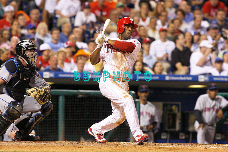 27 August 2008: Philadelphia Phillies' shortstop Jimmy Rollins (11) hits a long fly ball in the game against the New York Mets. The Mets. The Mets went on to win defeating the Phillies' 6-3 in Citizens Bank Stadium in Philadelphia, PA