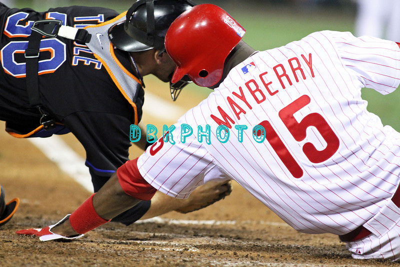 August 23, 2011  Phillies' outfielder, John Mayberry Jr, outfielder, #15 is out sliding into home trying to score on a ground ball during the game against the Philadelphia Phillies' at Citizens Bank Park in Philadelphia, PA. The Philadelphia Phillie's beat the New York Mets  9-4.