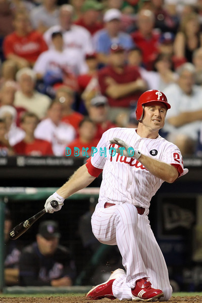 August 23, 2011  Phillies' #26 2nd Baseman, Chase Utley, goes down on one knee after hitting foul  ball  during the game against the Philadelphia Phillies' at Citizens Bank Park in Philadelphia, PA. The Philadelphia Phillie's beat the New York Mets  9-4.