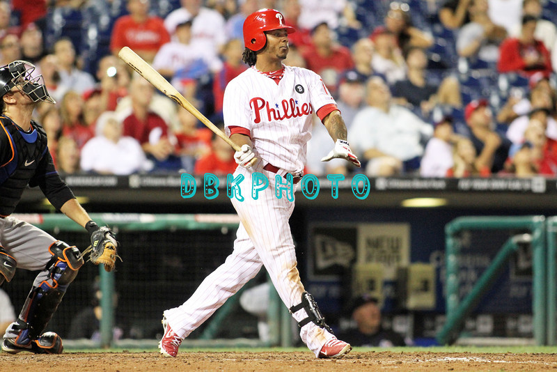 August 23, 2011  Phillies' Michael Martinez, infielder, #19, pops one up to the infield during the game against the Philadelphia Phillies' at Citizens Bank Park in Philadelphia, PA. The Philadelphia Phillie's beat the New York Mets  9-4.