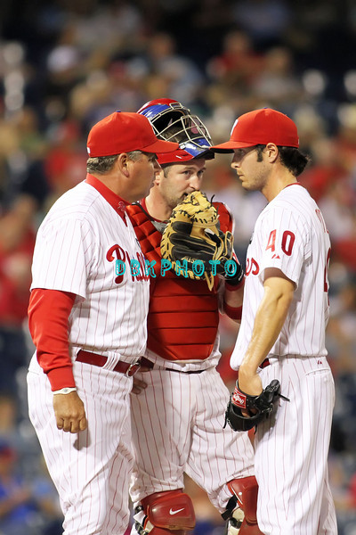 August 23, 2011  Phillies' pitching coach Rich Dubee #30, talks to Phillies' reliever Michael Stutes, #40 as catcher Brian Schneider listens during the game against the Philadelphia Phillies' at Citizens Bank Park in Philadelphia, PA. The Philadelphia Phillie's beat the New York Mets  9-4.