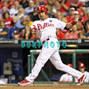 August 23, 2011  Phillies' #27 3rd baseman, Placido Polanco,hits a ground foul  ball  during the game against the Philadelphia Phillies' at Citizens Bank Park in Philadelphia, PA. The Philadelphia Phillie's beat the New York Mets  9-4.