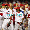 August 23, 2011  Phillies' team members high five each other to celebrate winning the game against the Philadelphia Phillies' at Citizens Bank Park in Philadelphia, PA. The Philadelphia Phillie's beat the New York Mets  9-4.
