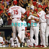August 23, 2011  Phillies' team members high five John Mayberry Jr after hitting a home run in the third inning the game against the Philadelphia Phillies' at Citizens Bank Park in Philadelphia, PA. The Philadelphia Phillie's beat the New York Mets  9-4.