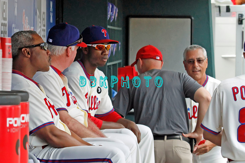 June 30, 2011  Philadelphia Phillie's have a pre-game dugout meeting between #41 Manger Charlie Manuel and #9 outfielder, Dominic Brown during the game against the Philadelphia Phillies' at Citizens Bank Park in Philadelphia, PA. The Red Sox beat the Phillies' 5-2.