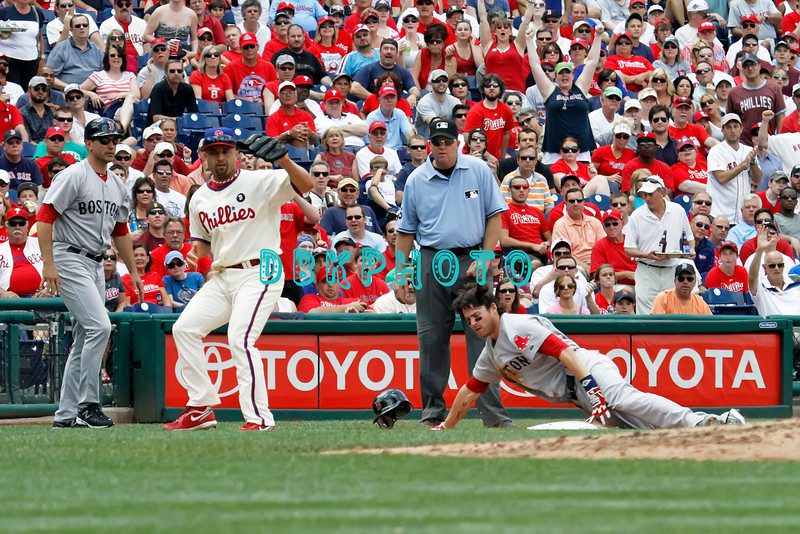 June 30, 2011  Boston Red Sox outfielder #16 Josh Riddick slides into 3rd base as he hits a triple to center field during the game against the Philadelphia Phillies' at Citizens Bank Park in Philadelphia, PA. The Red Sox beat the Phillies' 5-2.
