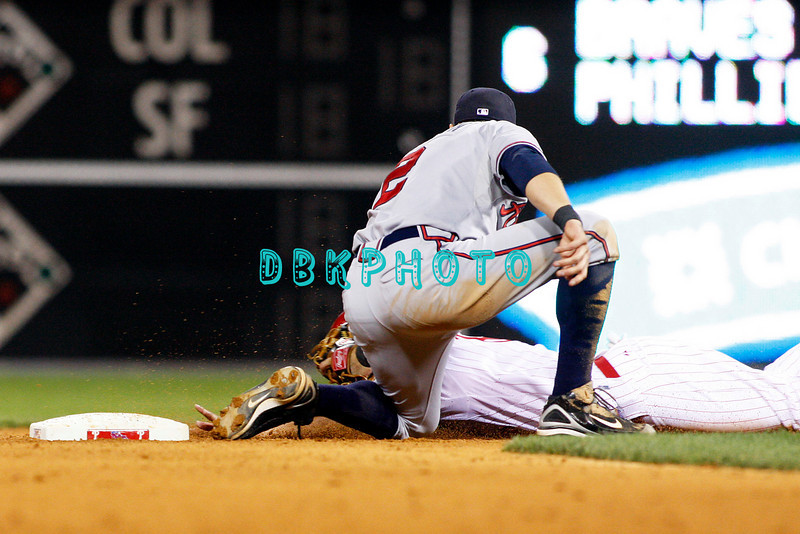 23 September 2008: Philadelphia Phillies' center fielder Shane Victorino (8) is tagged out on the head before his fingers could reach the base  by Braves 2nd baseman Kelly Johnson (2) in the game against the Atlanta Braves. Atlanta went on to win defeating the Phillie's 3-2 in Citizens Bank Stadium in Philadelphia, PA