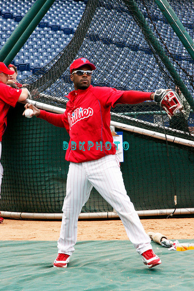 30 September 2008: Phillie's shortstop Jimmie Rollins lossens up with the team in the early afternoon. The Philadelphia Phillie's and Milwaukee Brewers took the day before the first play off game to hold press conferences and a light field workout at Citizens Bank Stadium in Philadelphia,  PA