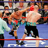 KELLY PAVLIK (black shorts) vs SERGIO MARTINEZ (black shorts with white trim)