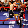 18 October 2008: Kelly Pavlik (black trunks) lands a right to the head of Bernard Hopkins (black trunks, white trim) during their 12 round bout in Atlantic City, New Jersey.  Hopkins won by decision