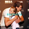 ATLANTIC CITY, NJ - SEPTEMBER 17:  Olympic swimmer Michael Phelps hugs a fan, Kristy,12 before he hosts a party at The Pool at Harrah's Resort on September 17, 2011 in Atlantic City, New Jersey.