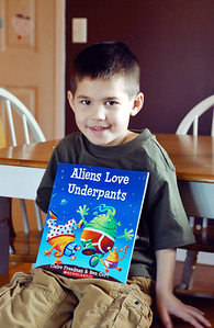 "January 24th - 024/365  It's official: my boy can read! Tonight before bed I had him take out a stack of books to look through. I promised that after I got Grace into bed and cleaned up in the kitchen I would read him one.  When we sat down, he started tapping-out his words. After tapping a few in a row and pronouncing them all correctly, I yelled ""I didn't know you could read!"" He smiled and said ""I didn't know THIS was reading! I thought this was just called tapping-it-out!"""