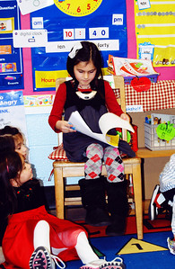 January 8th - 008/365  Today was Emily's Publishing Party at school. It was wonderful! All of the students wrote their own non-fictional short stories. They wore microphones around their necks and everyone had a parent or sibling in the audience.  Emily's story was all about her curly hair. She wrote about taking a shower, thinking about curling her hair, bringing me the bag of curlers and then thinking about how her friends and teacher would think she was so pretty the next day at school.
