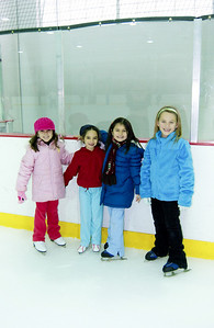 January 2nd - 002/365  I took Emily & Andrew ice skating last night so that Emily could feel comfortable during Olivia & Sophia's skating party this morning. Mission accomplished.  Pictured L-R: Bianca, Maya, Emily & Olivia