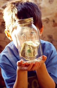 January 10th - 010/365  Thanks to Andrew, we now have a glass jar sitting on the dining room ledge filled with dollar bills (actually there are only two bills in there at press time and yes, both are his). Bad words and bad attitudes are a fast way to lose dollars from your piggy bank and have them held captive in this jar. Lets hope it doesn't get filled too fast.