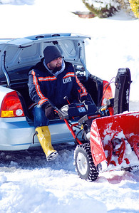 February 11th - 042/365  Unsure whether Vin would make it home after 24 hours of being stuck at work during the blizzard (he did), Matt & Dad came up the block to snow blow my sidewalks and driveway.  This is how they got the actual snow blower 7 blocks up to my house. Setting a fine example indeed.