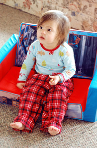 January 28th - 028/365  Just a sweet picture of my little girl, basking in the morning sunshine (Cheerios in hand).  p.s. Have I mentioned how much I absolutely love when this kid wears flannel pajama pants? She looks like such a little meatball in them! ♥