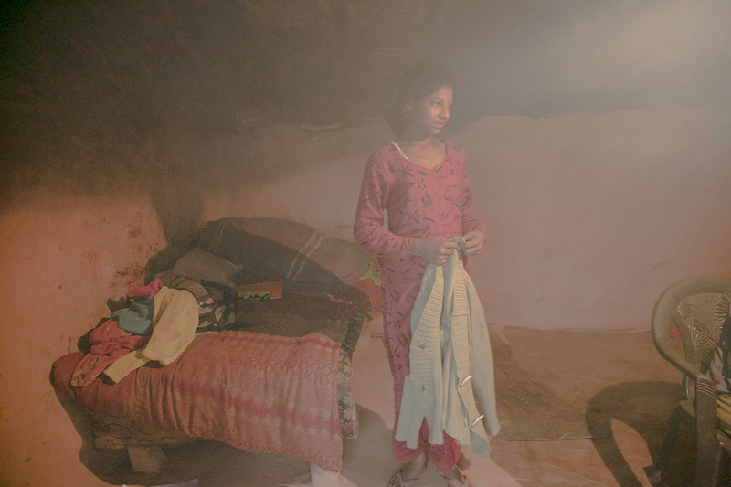 Manisha just finished cooking; the room was filled with smoke of firewood stove.