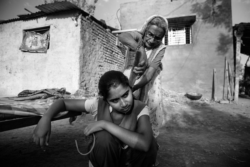 """""""I have never worked in fields, I don't like it either. I am studying hard to be a doctor and serve those who can't afford it"""" - Vaishnavi Thakre, 13, Chitra's elder daugther. Anajana Bai Thakare and Vaishnavi."""