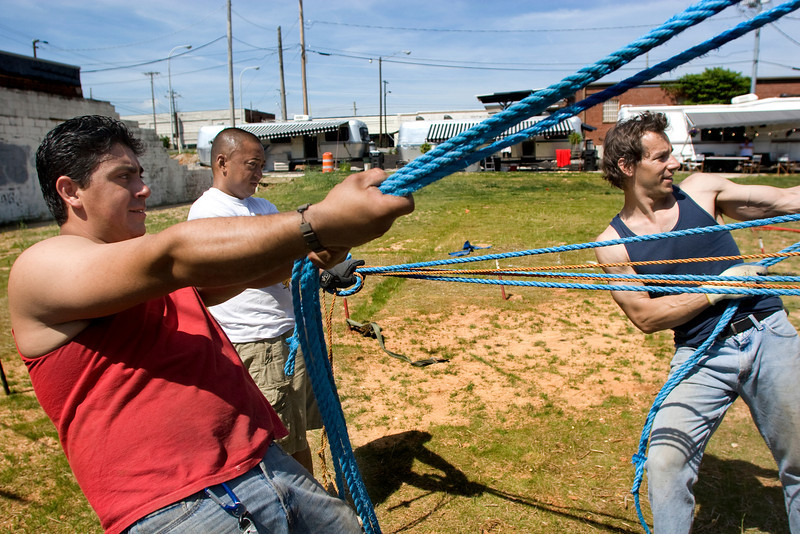 Performers of the Zoppe' Circus, from left, Alfonso Cubillos, Rob Nacu and Carlo Gentile take down the big top before traveling to the next town Sunday, April 26, 2009.