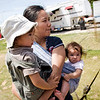 Orlene Gentile keeps her children, Gianluca, left, and Giulia, with herself to prevent them from getting close to where the men are taking down the big top on Sunday morning.
