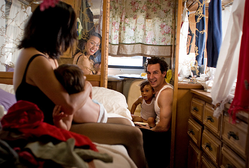 "Orlene, left, and Carlo Gentile, right, witness a ""historic family moment"" (as Carlo put it) as their son, Gianluca, uses the potty in their trailer for the first time in his life Saturday, April 25, 2009."