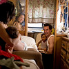 """Orlene, left, and Carlo Gentile, right, witness a """"historic family moment"""" (as Carlo put it) as their son, Gianluca, uses the potty in their trailer for the first time in his life Saturday, April 25, 2009."""