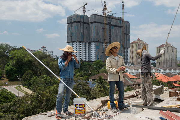 3 of Migrants workers are preparing for painting work on the top roof of an Islamic mosque at Segambut, Kuala Lumpur.