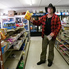 "Sunday, June 7, 2009, somewhere in Bibb County, Ala. While his horse is feeding in a nearby field, Joe Guy goes to a shop to buy some groceries. There's some confusion between Guy and the shop owner, Sid Cannon (not pictured), when the Australian asks for biscuits, meaning (in American English) ""cookies."""