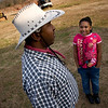 "Collis Crayton listens to her granddaughter, Modesty Rena Taylor, and patiently answers all of her questions about horses and animals in general Sunday, February 8, 2009. ""I've always liked being around kids,"" says Crayton, ""That's what brought me to education in the first place."" He says that not only they learn from him, but he also learns from them. ""You know, I spend my time in two very different environments: at school, surrounded by kids, and then,  I go to the barn and I'm around animals. I mean, I'm between two diferent worlds and enjoy both of them."" That's because,  he points out, he learns from both kids and animals, ""and all of them keep me happy and smiling."""