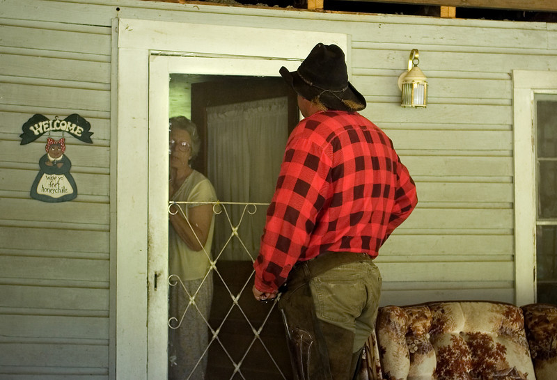 Sunday, June 7, 2009, somewhere in Bibb County, Ala. Joe Guy asks for permission to rest with his horse in a field at the back of this woman's house during the hot hours of the day.