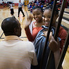 "Twin sisters Cierra, center, and Tierra Wallace greet Collis Crayton during a basketball game at Decatur High School Friday, January 23, 2009. The Wallace sisters have known Crayton since he was a substitute teacher at Brookhaven Middle School. ""He's the funniest person to be around,"" said Cierra, ""and he's like a father to us,"" Tierra added."