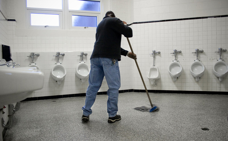 "THE SECRET LIFE OF COLLIS CRAYTON, JANITOR AND COWBOY<br /> Collis Crayton cleans one of the restrooms at Decatur High School Thursday, January 15, 2009. ""A lot of people look at it [this task] like 'I don't want to do that; I don't want to clean toilets; I don't want to clean this or that.' But I don't mind cleaning. I mean, it's necessary and somebody has to doit, and, hey, they chose me. So, I clean it."""