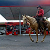 Joe Guy rides by a gas station in Tuscaloosa, Ala. Saturday, June 6, 2009.