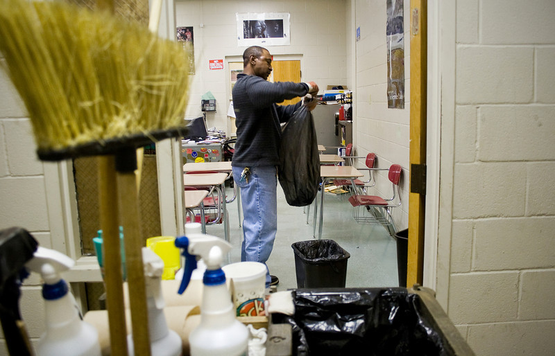 Collis Crayton cleans one of the classrooms at Decatur High School Thursday, January 15, 2009.
