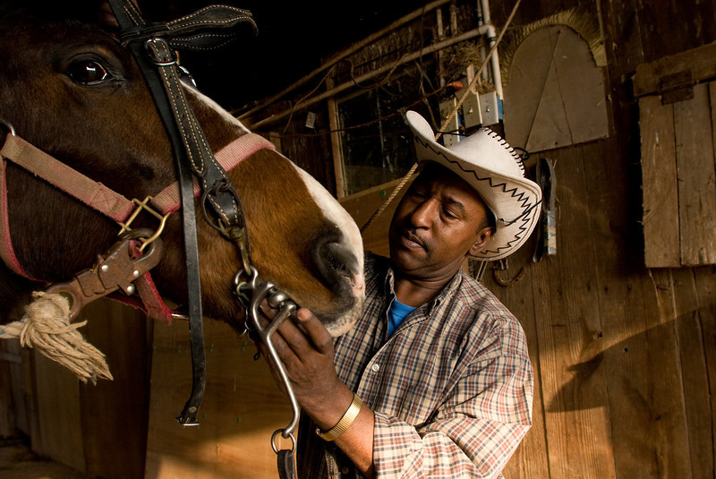 Collis Crayton prepares a mare to ride Monday, March 9, 2009.