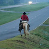 "SUMMARY: Joe Guy, an Australian cowboy and singer/song writer, is living a dream: to celebrate his 40th birthday riding solo across the U.S. He is doing it like cowboys used to. He has no support car, no fresh horses waiting for him; he sleeps under the stars, using his saddle as a pillow. And, along his journey, he's helping the people he comes across in many different ways.<br /> Pictured - On Sunday, June 7, 2009, Joe Guy gets up at dawn and starts riding around 5 a.m. He has to cover as much distance as possible before the heat of the day affects his horse, ""Bon Jovi""."