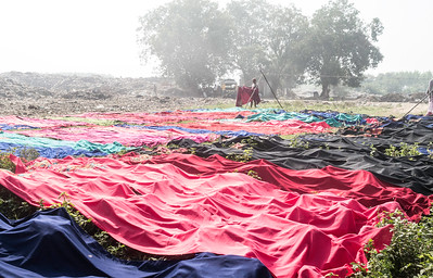 A laundary is established nearing to Bhagtanwala dump site where the new clothes from the factory are being washed before being sold to the market.
