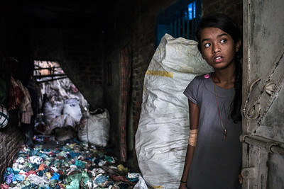 The girl's home in bangla baazar is filled with garbage as the family is involved in recycling the garbage. There is no plant provided by the government.