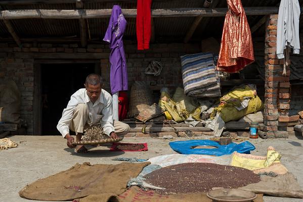 Kumari's father, Siddhi Bajra Bajracharya (57) is doing daily housework on the rooftop .Bungamati, Nepal, 2014