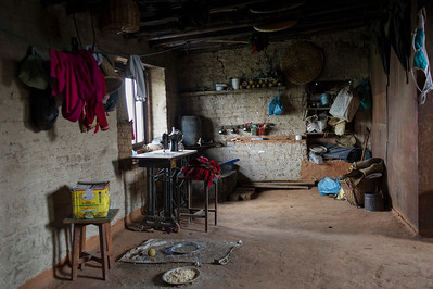 General view of their living room. There is a small place for washroom at a corner. Bungamati, Nepal, 2014