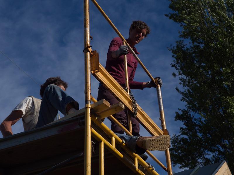 Aliyah and John wrestling the scaffolding