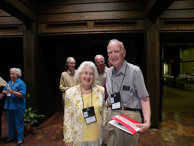 foreground:  Lorraine '43 and Bill Briggs '44.  Background:  Professor of Accounting JoAnn Hopkins, Carole and Dave Carter '59.
