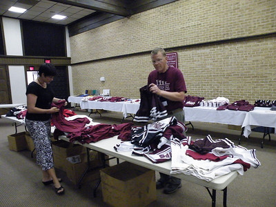 PUAFA Board Members Tanya Reitan and Dave Burke working the Shopping Mall on Friday June 26th of the reunion.  This table features athletic memorabilia for sale through the PU office for $5 per item.