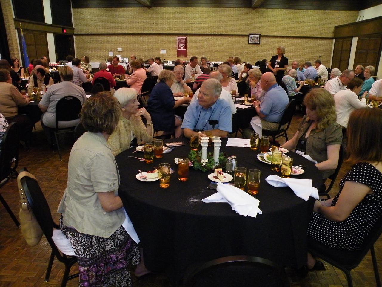 Near table facing camera:  Dorothy Trueblood Elliott '48, Max Jones, and Lori Hunter '86.